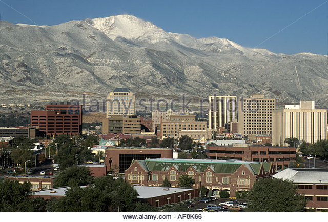 Colorado The West Rocky Mountain State Colorado Springs downtown skyline snow capped Pike's Peak - Stock Image