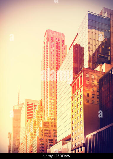 Vintage instagram filtered photo of skyscrapers in Manhattan at sunset, New York City, USA. - Stock-Bilder