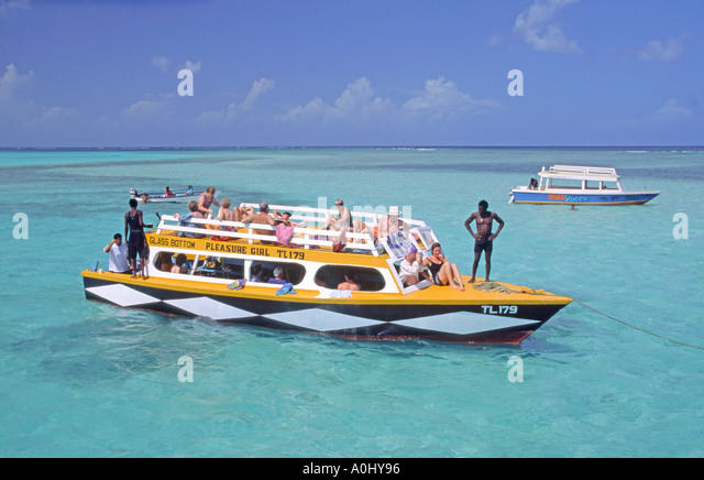 Tobago Pigeon Point caribbean sea Buccoo Coral Reef tourist boat - Stock Image