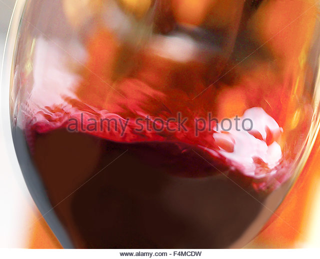 Red wine swirl in a glass - Stock Image