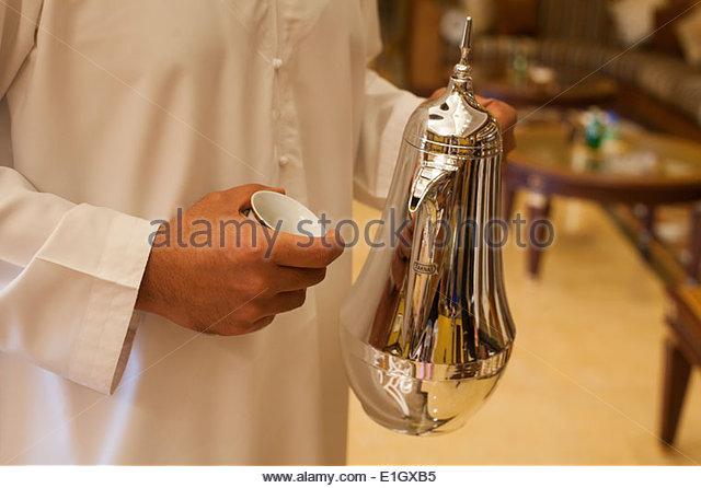 Arab holding a silver coffeepot - Stock-Bilder