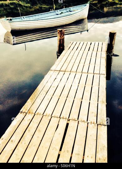 Wooden Jetty and Boat - Stock-Bilder