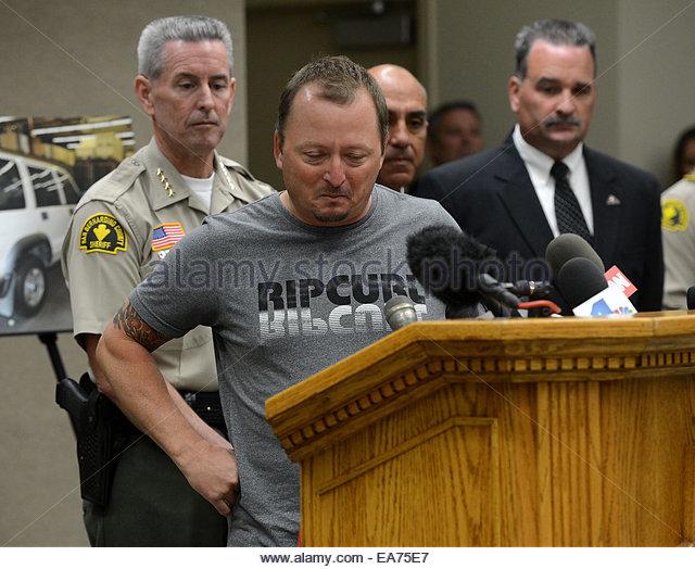 San Bernardino, California, U.S. 7th Nov, 2014. MICHAEL MCSTAY reacts while talking to the media after San Bernardino - Stock Image