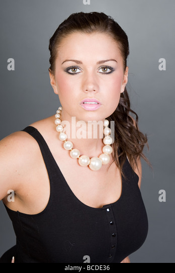 Shot of a Stunning Teenager against Grey Background - Stock Image