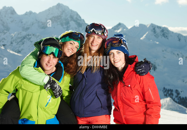Friends with arms round each other, Kuhtai, Austria - Stock Image