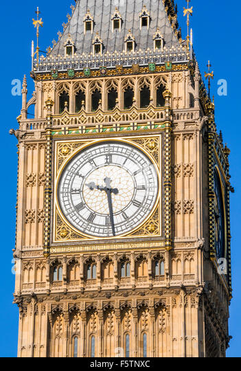 Big Ben clock face clock tower above the Palace of Westminster and houses of Parliament City of London England UK - Stock Image