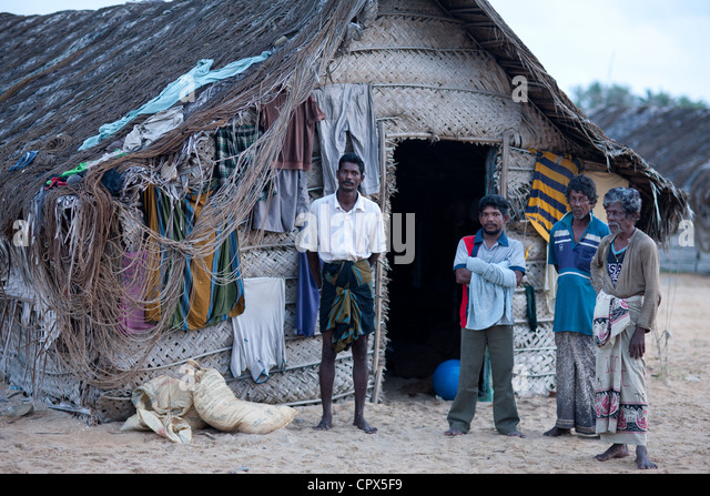 fishermen in front of their beach hut at Kalpitiya, Sri Lanka - Stock Image