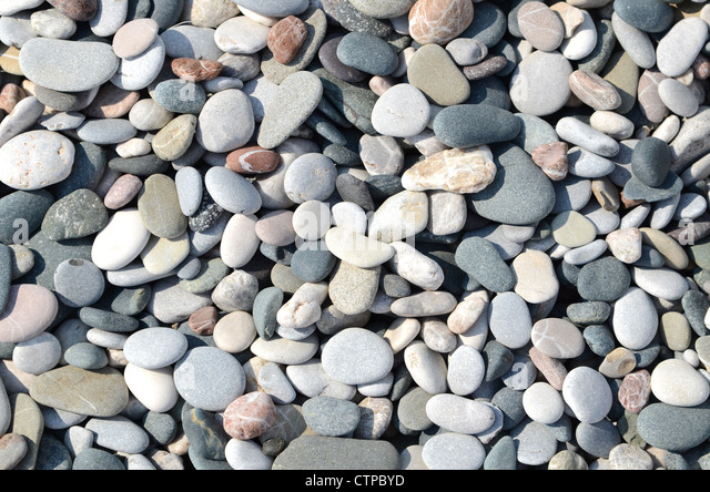 A stone background from a dry river bed - Stock Image
