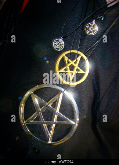 Four Metallic Pentagrams Five Pointed Stars Against a Black Background Copy Space - Stock Image