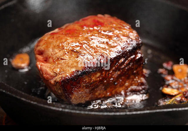 Beef steak on cast iron skillet with empty space for text - Stock Image