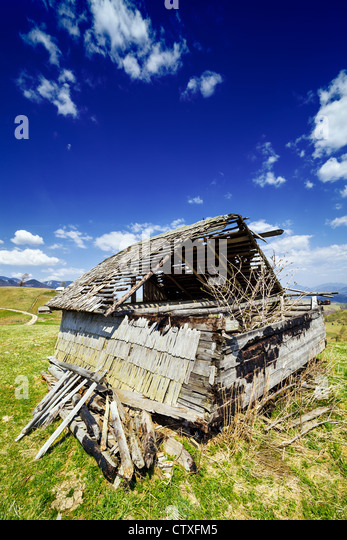 Landscape with an abandoned wooden shack - Stock Image