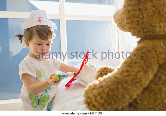 Girl in costume playing nurse - Stock Image