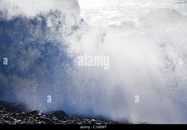 Heavy Atlantic seas with large waves crashing onto rocks at Ajuy on the Canary Island of Fuerteventura - Stock Image