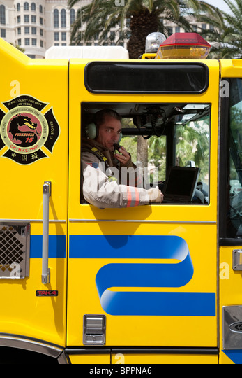 Fireman in a Clark County firetruck on the strip, Las Vegas Nevada USA - Stock Image
