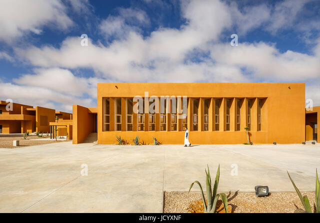 Landscaped square with arrangement of buildings. Laayoune Technology School, Laayoune, Morocco. Architect: Saad - Stock-Bilder