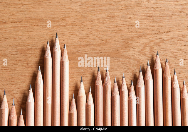 Wooden pencils in a row - Stock Image