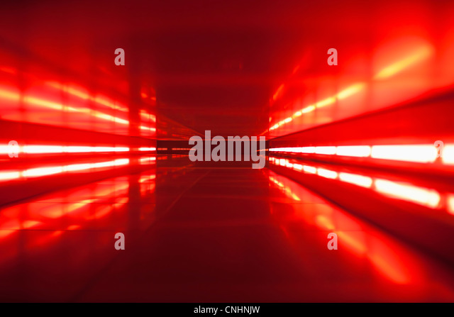 An abstract corridor in red tones - Stock Image
