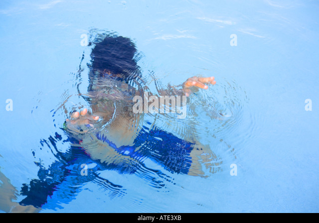 Asian boy swimming - Stock Image