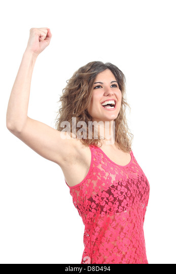 Ecstatic beautiful girl with her arm raised isolated on a white background - Stock Image