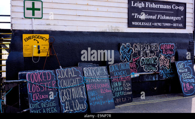 Leigh Fishermans Coop displaying prices of their fish for sale. - Stock Image