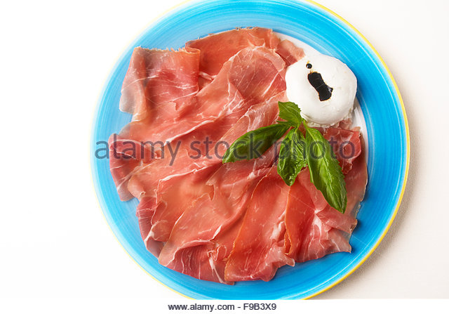 Burrata cheese,and prosciutto salad - Stock Image