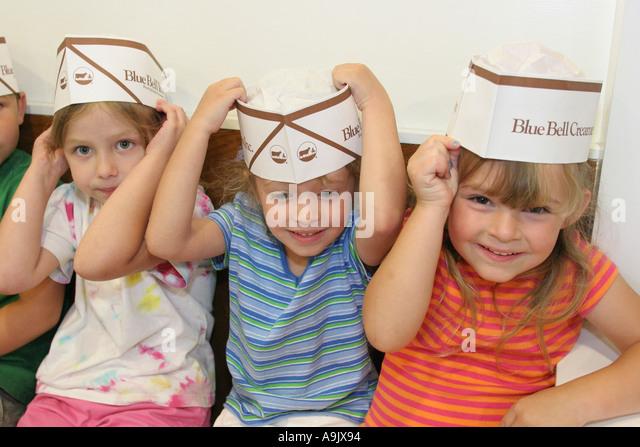 Alabama Sylacauga Blue Bell Creameries children hats - Stock Image