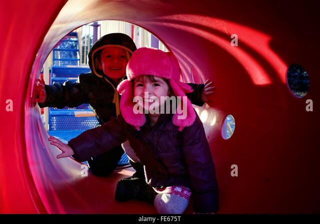 Children In Playground Tunnel - Stock Image