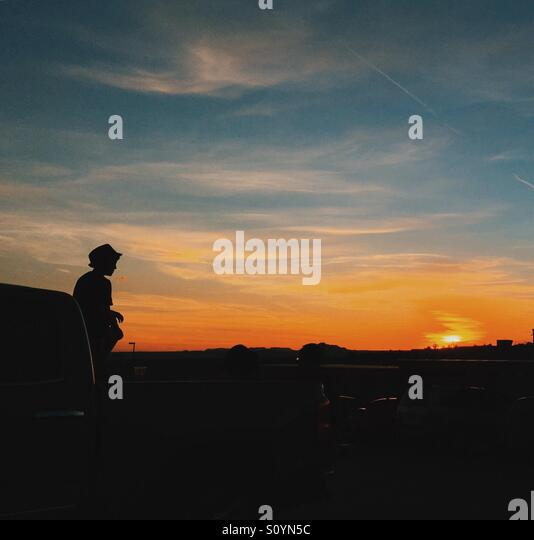 Watching the sun set - Stock Image