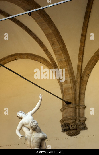 Stature Reaches For Iron Bar, Looking Up, Palazzo Vecchio, Florence, Italy - Stock Image
