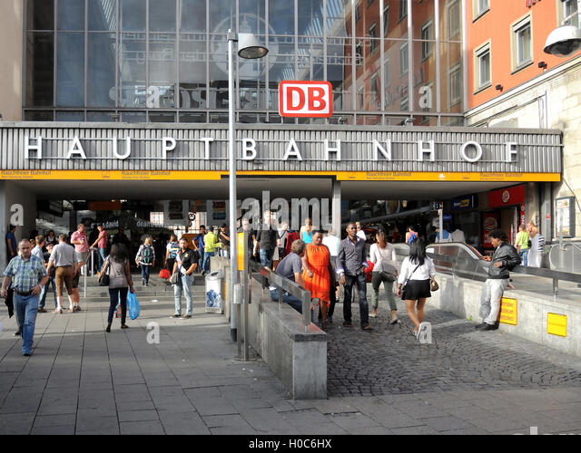Central Station of Munich in Germany with people outside of the entrance area. - Stock Image