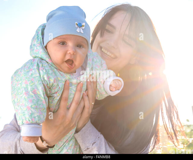 Mother and baby with backlight - Stock Image