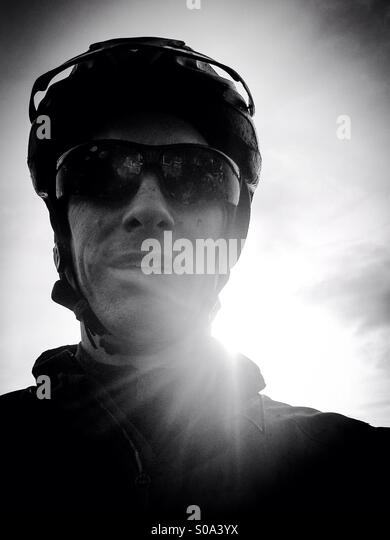 Mountain bike rider selfie portrait gritty black and white. - Stock-Bilder