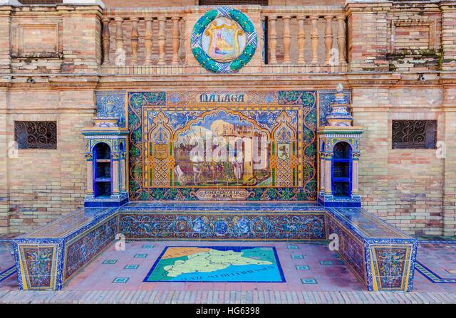 Glazed tiles bench of spanish province of Malaga at Plaza de Espana, Seville, Spain - Stock Image