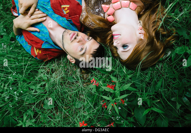 Couple Laying on Grass Field, Close Up, High  Angle View - Stock-Bilder