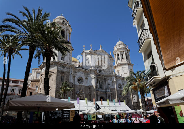 Exterior view of the frontal facade of Cadiz Cathedral (Catedral de Santa Cruz de Caziz) and Plaza de la Catedral, - Stock Image