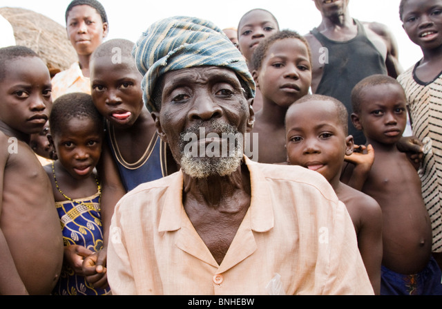 The chief of Bouchipe, a village in the Gonja Triangle, Damango district, with some of the children of the village. - Stock Image