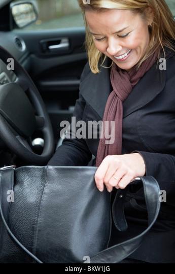 Woman with handbag in car - Stock Image