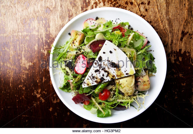 Greek salad with feta cheese, beets,artichoke and,radishes - Stock Image