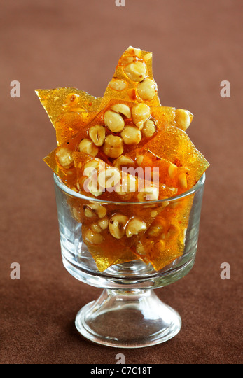 Hazelnut, rosemary and orange brittle in a bowl, by pastry chef Laurie Pfalzer, Pastry Craft - Stock Image