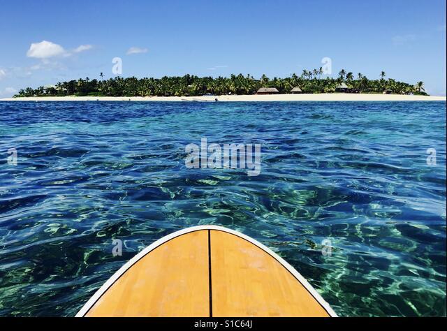 Tavarua island from the water on a stand up paddle board. Tavarua Island, Fiji. - Stock Image