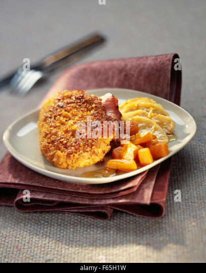 Chicken escalope with parmesan and Ginger bread crust - Stock Image