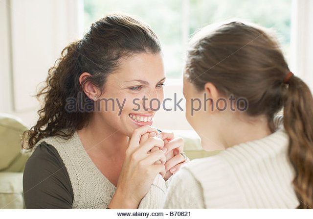 Mother and daughter holding hands - Stock Image