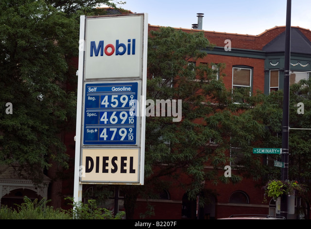 Sign at a Chicago gas station showing regular gas selling for 4 59 cents - Stock Image