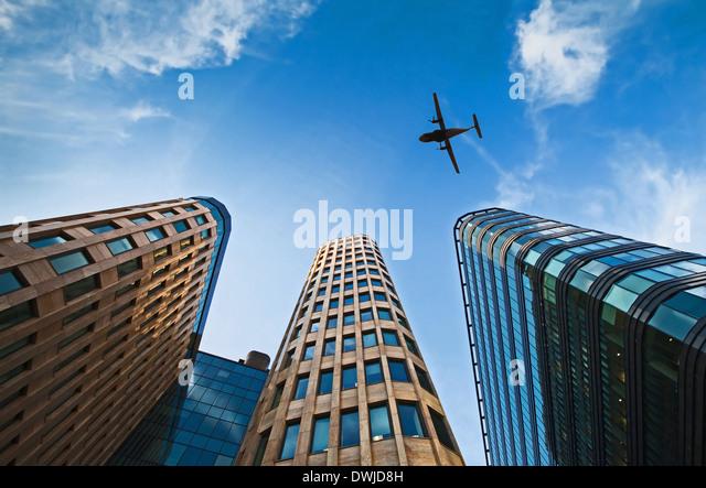 plane over office buildings - Stock-Bilder