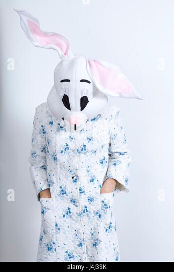 bunny difficult to wake in the morning dressing-up clothes and conceptual parody - Stock Image