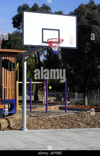 Basketball Ring and Backboard Outdoors - Stock Image