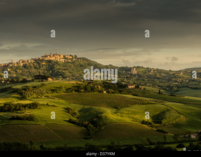 a view of a town of tuscany in the light of a sunset - Stock Image
