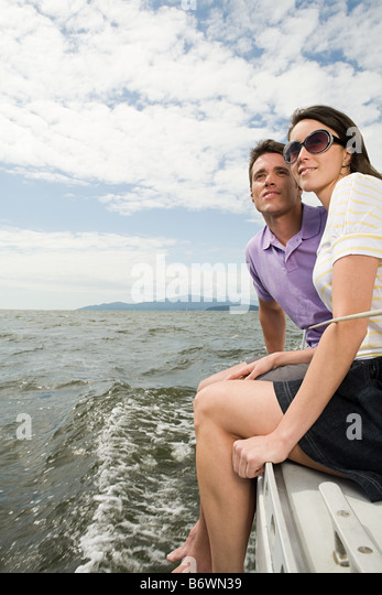 Couple traveling on a sailing boat - Stock-Bilder