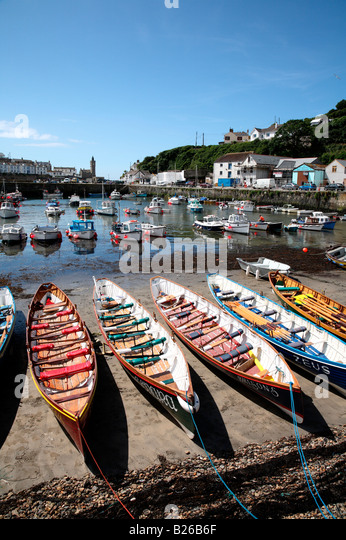 Gig boats lined up on the harbour beach in Porthleven, Cornwall UK. - Stock Image