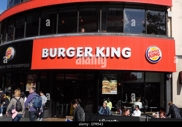 Burger King in Leicester Square, London, England. - Stock Image